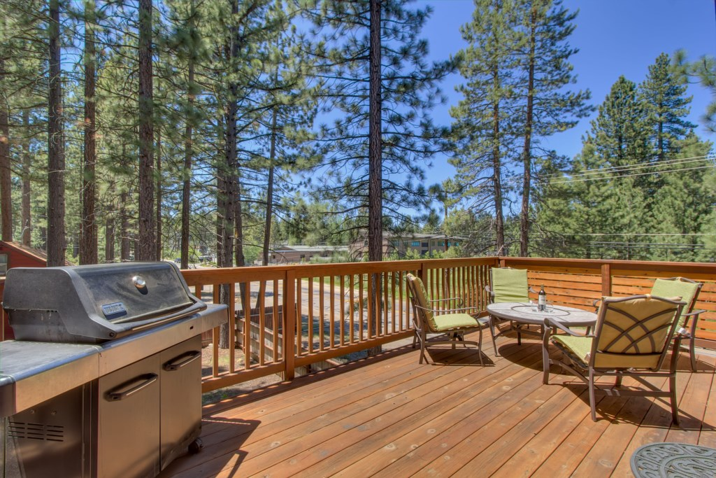 Enjoy and relax on your backyard deck with grill and seating