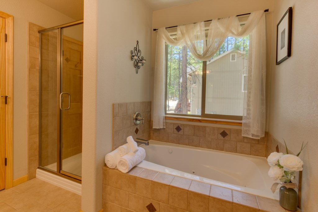 Enjoy a seperate Jacuzzi Bathtub and walk-in shower