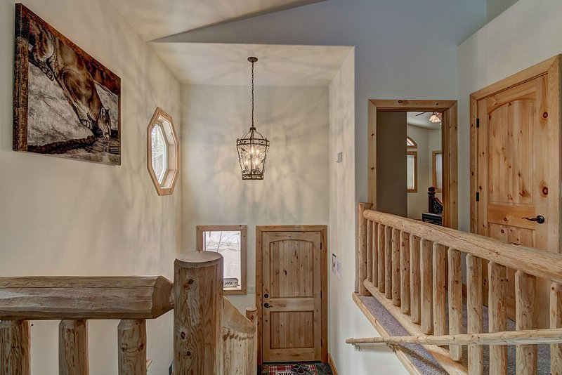 Enter this beautiful  two-story cedar home to see all it has to offer