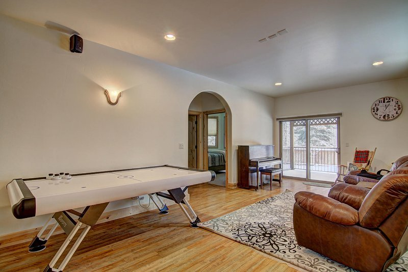 Gather in the Family room to enjoy a game of Air Hockey ~ There is also a piano for music lovers