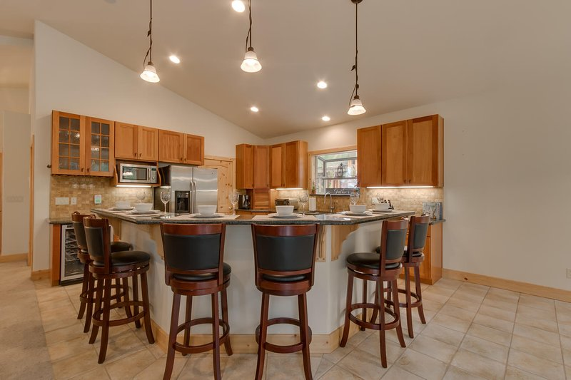 Conversation will flow easier in the open plan Kitchen/Dining and Living area