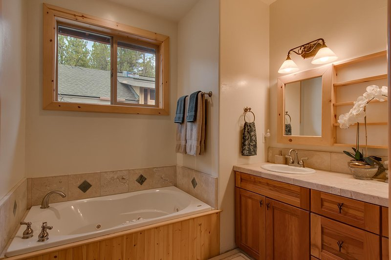 Soak away the aches of the day in your Master Bath Jacuzzi Tub
