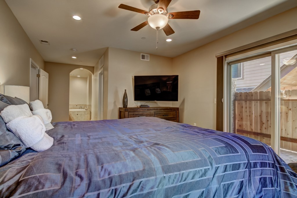 Get comfy in the second Bedroom furnished with Queen Bed and TV