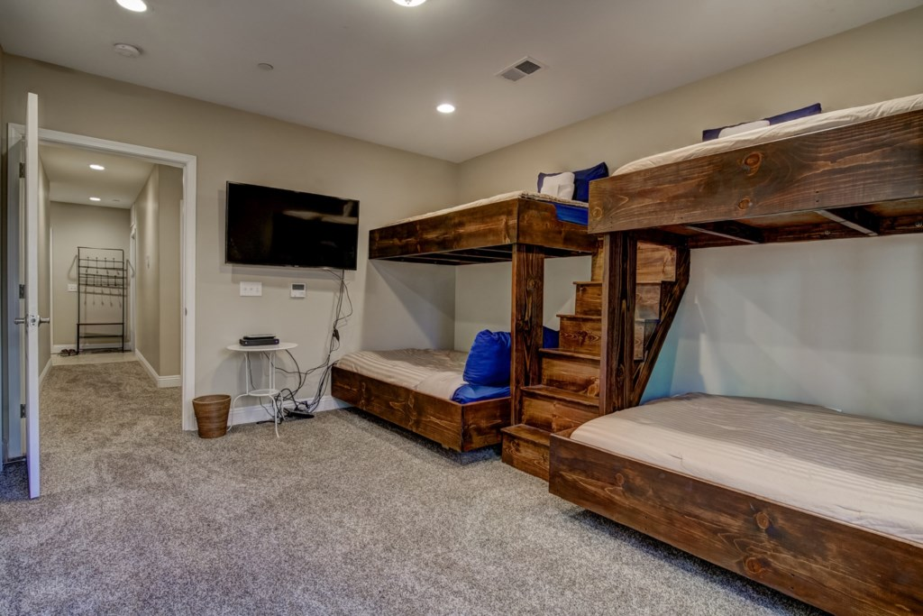 Spacious Bunk room with mounted TV