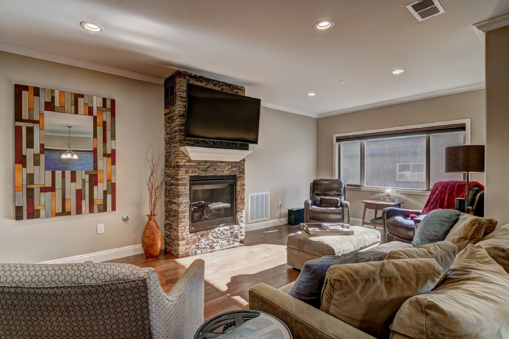 This home features a spacious open floor plan with stone fireplace