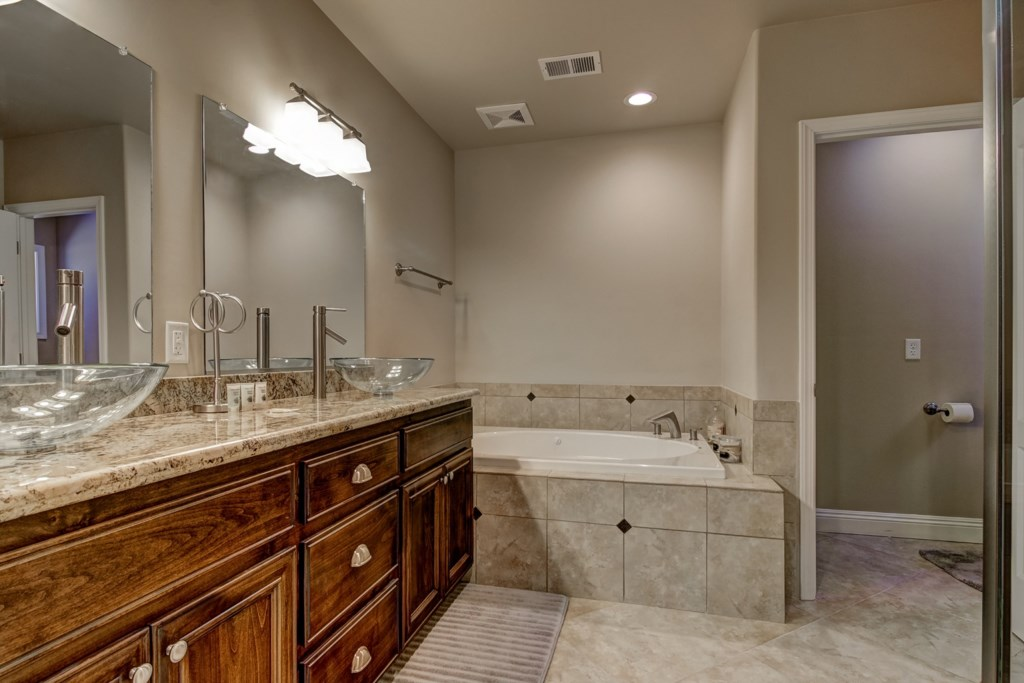 Soak away the days aches in the Master Bathroom Jacuzzi tub