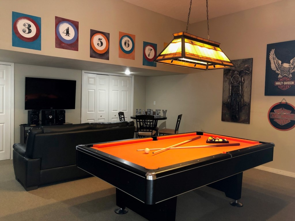 Air conditioned games room with pool table, air hockey, PS3 and large sofa
