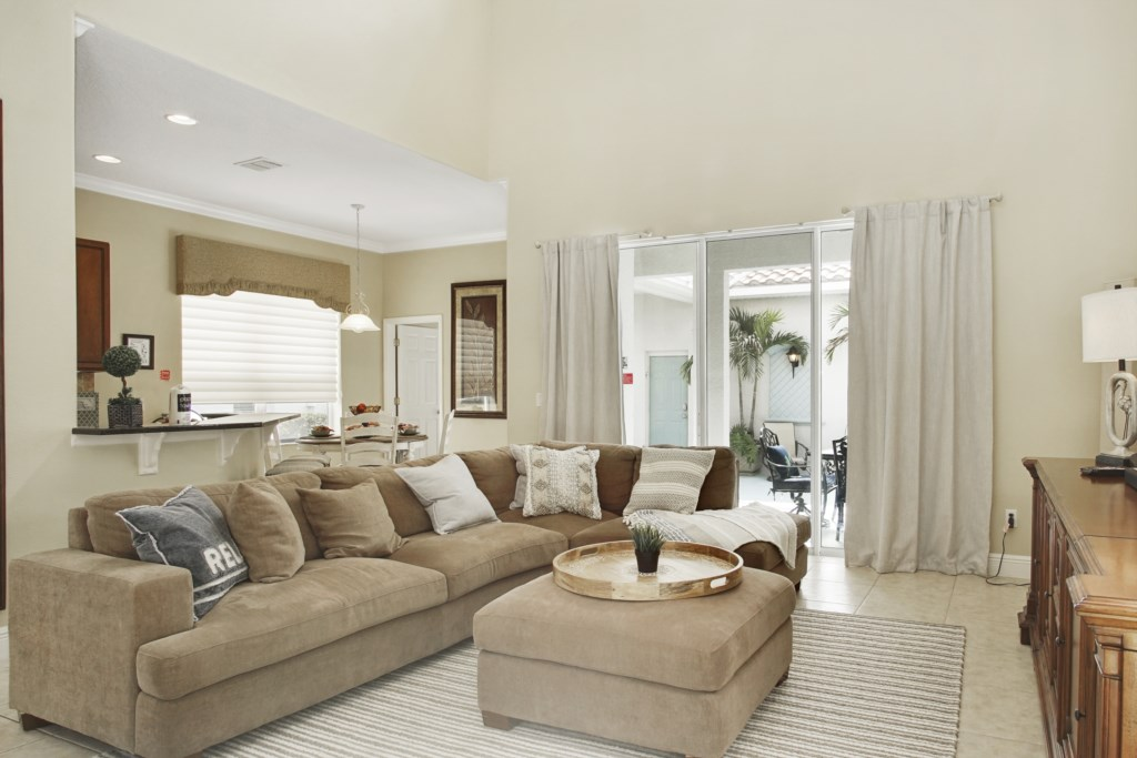 Large sectional sofa for relaxing and enjoing the large flat screen TV & views of the pool area