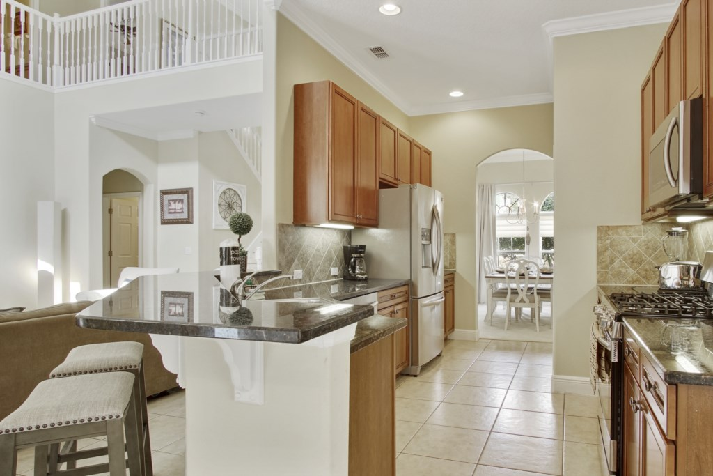 Kitchen vew into formal dining area at the front of the house