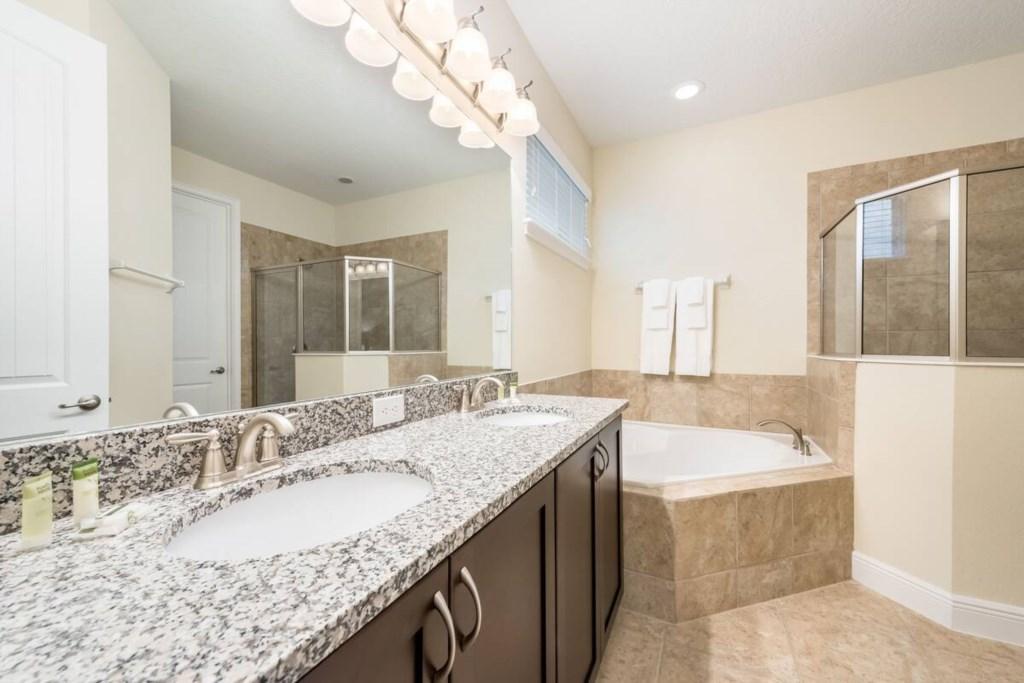 1st Floor Master Bathroom, double sinks, stall shower and garden tub.