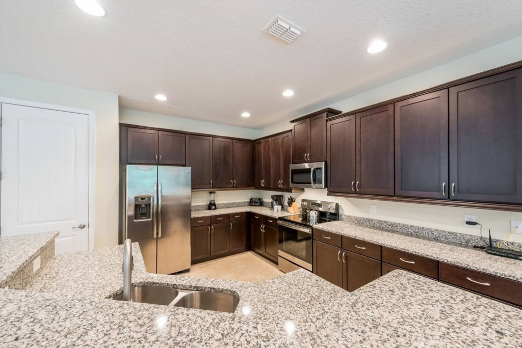 Spacious Fully Equipped Size Kitchen, Ganite and Stainless Steel