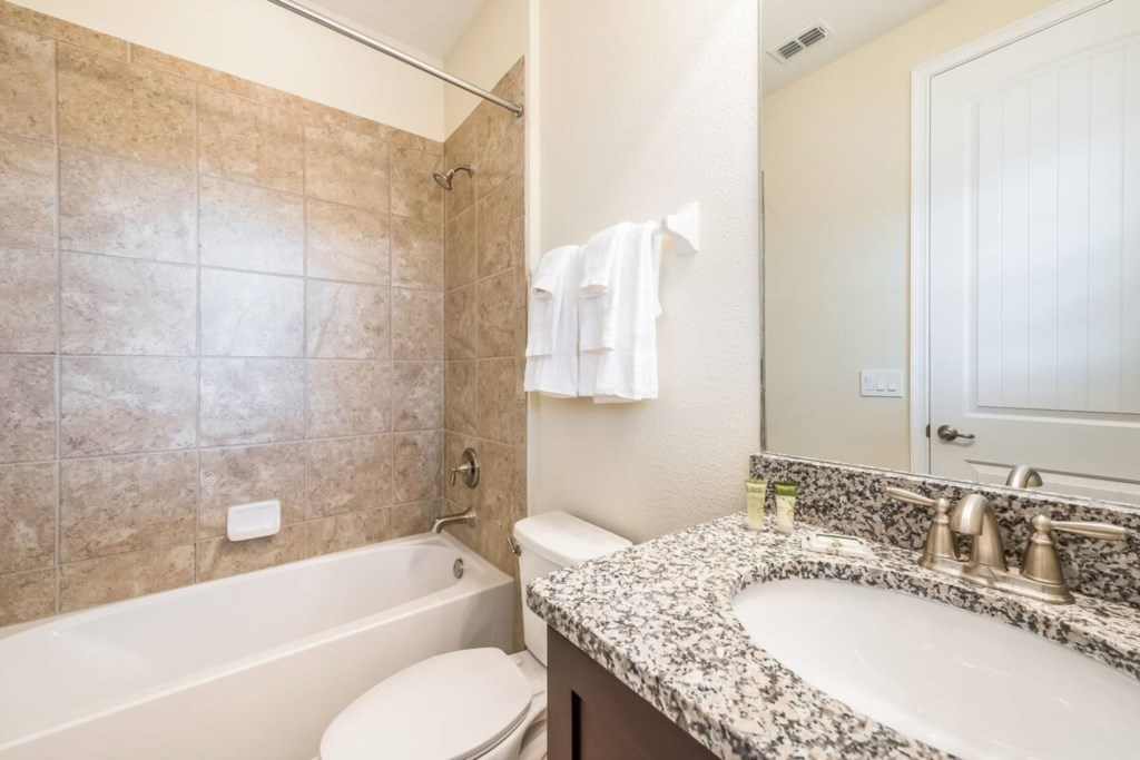 On Suite Double Bed-  Bath, Shower/Tub, also opens to loft