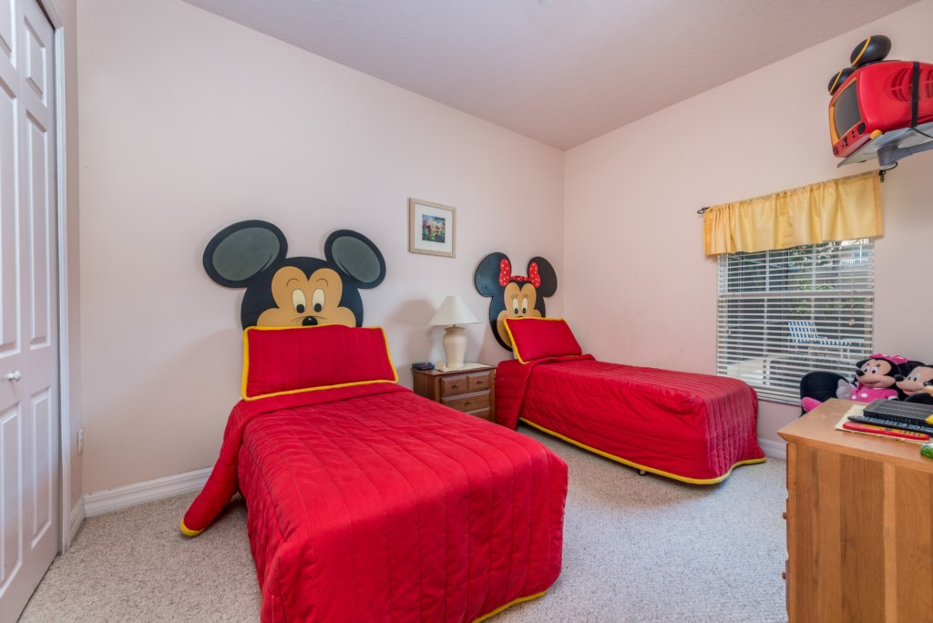 Adorable 2 Mickey and Minnie twin beds with flat screen TV
