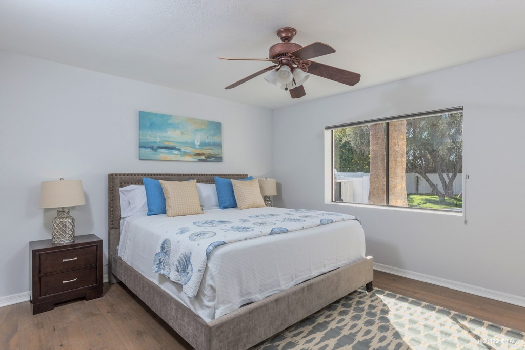 Bedroom 3 has a king sized pillow top bed and a great view to the backyard and pool