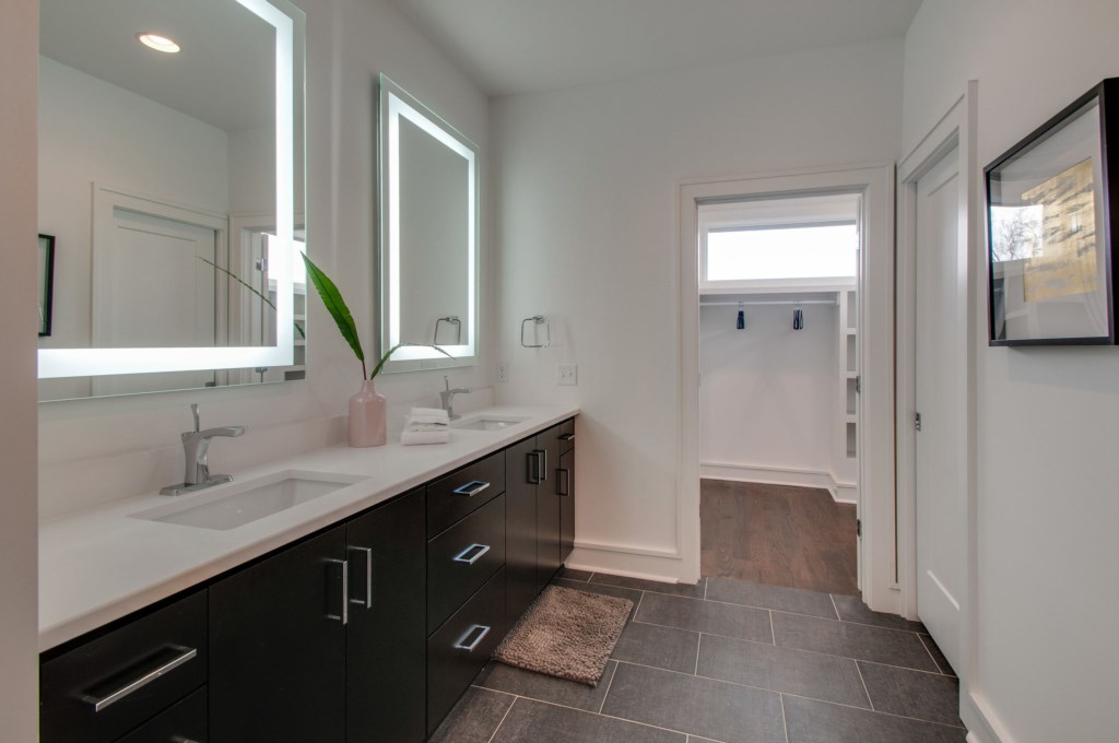 Spa Master bathroom with dual vanity, quartz countertops, and custom shower.