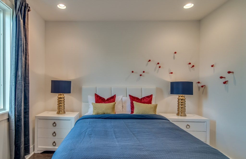 Great lower level bedroom with queen bed and bathroom right outside the door.