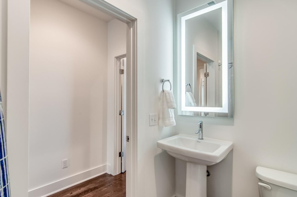 Lower level bathroom with standup shower.