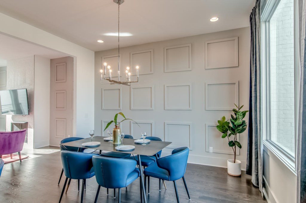 Beautiful dining area with paneled wall.
