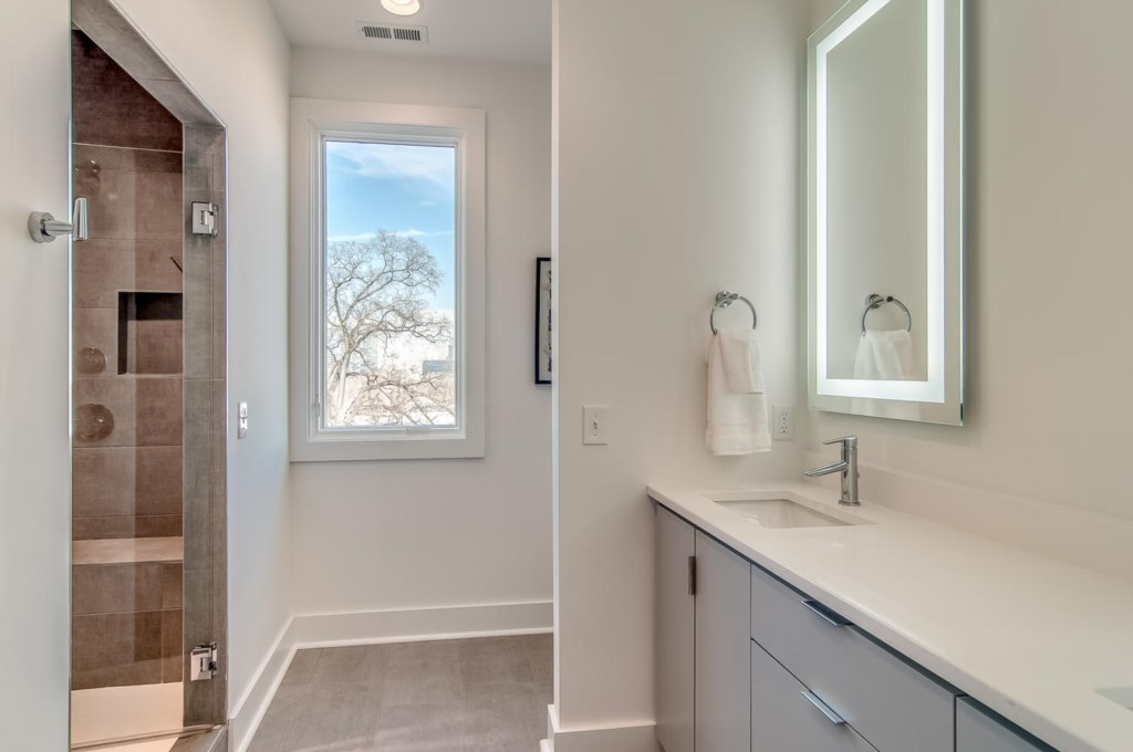 Spa Master bathroom with dual vanity, quartz countertops, custom shower.