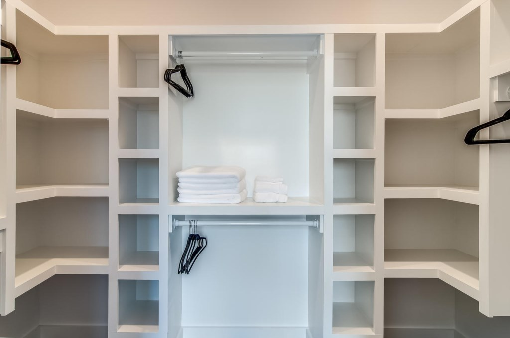 Large master closet with extra linens