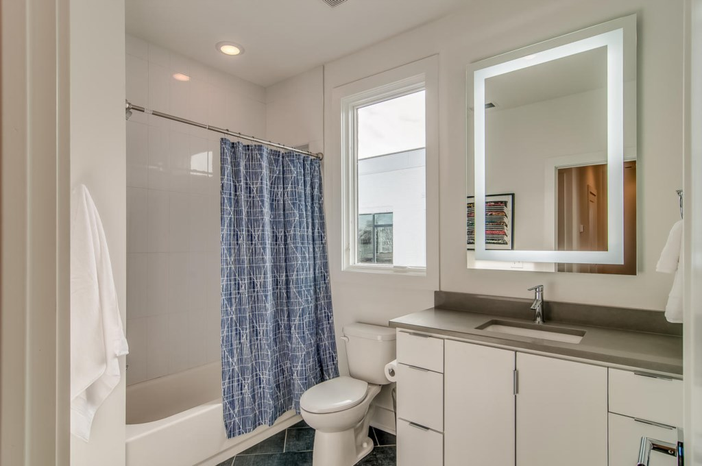 Beautiful hall bath that services bunk bed room.