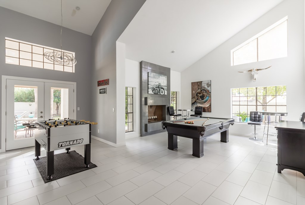 Large entertaining space with pool table, flat screen TV, foosball and more!