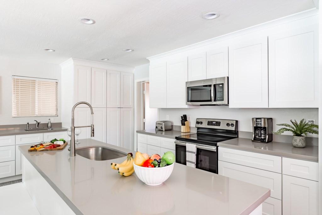 Kitchen-Island-and-Stainless-Steel-Appliances.jpg