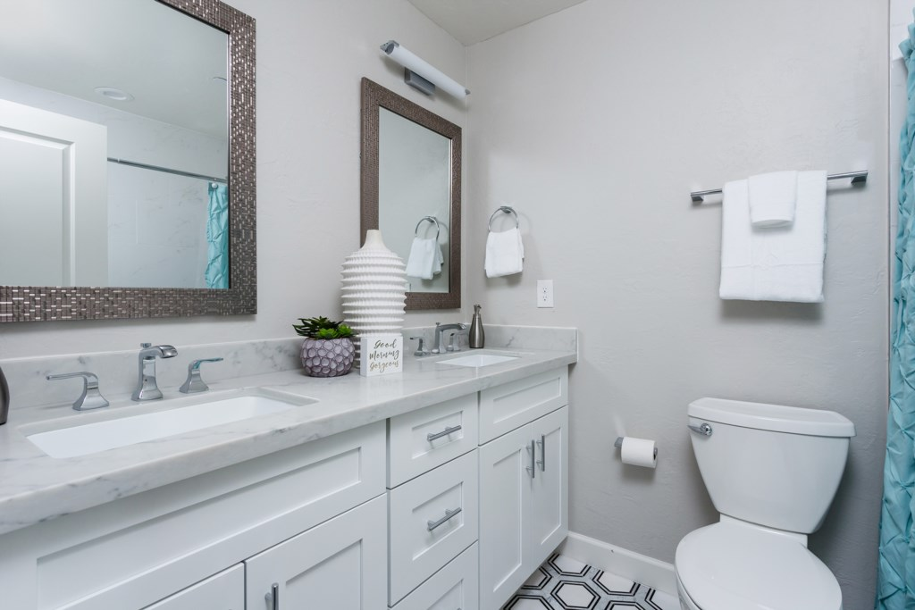 Large 2nd bathroom with double sink vanities
