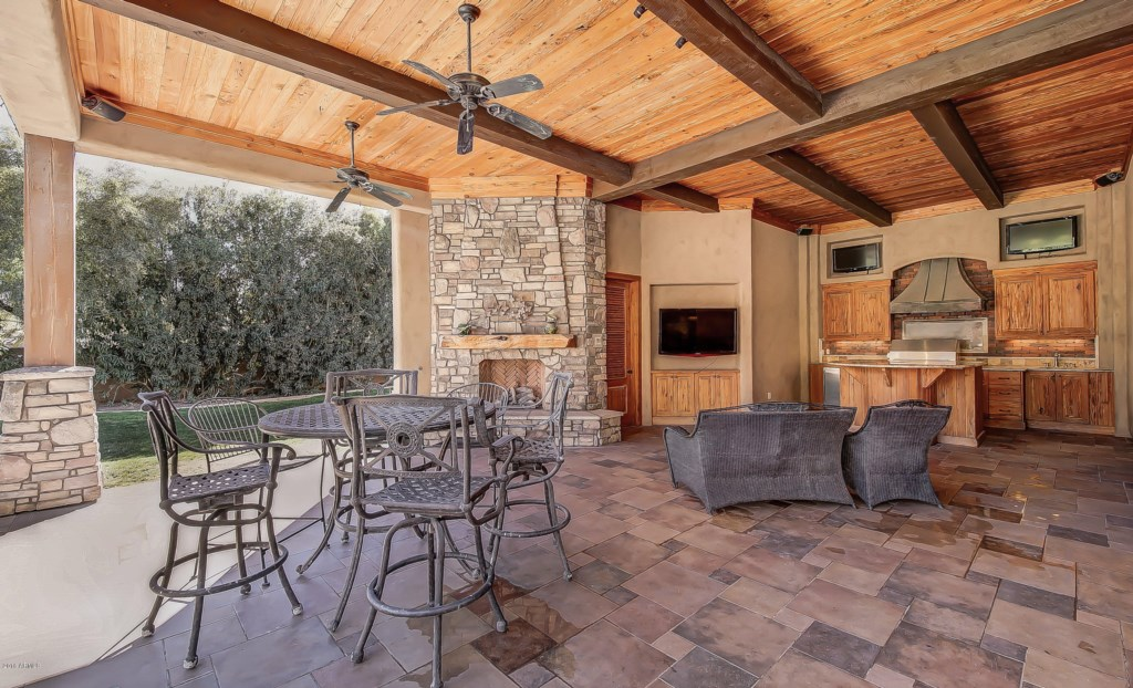 Backyard-Patio-with-Grill-TV-Fireplace