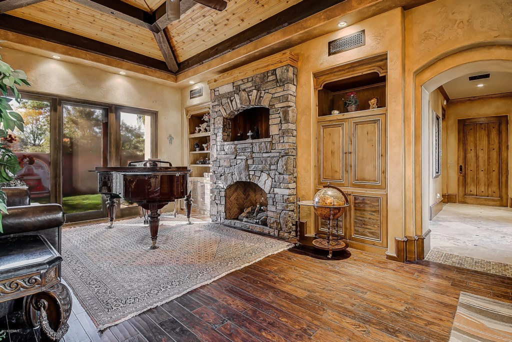 Living-Room-With-Piano-and-Fireplace