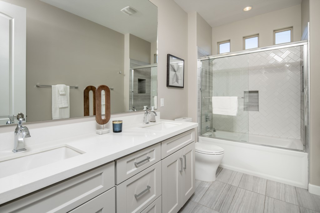 4th Bathroom with Large jack and jill vanity and shower/tub combo