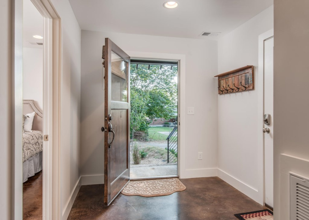 Hardwood floors and lots of light are just some of the warm and inviting touches that greet you.