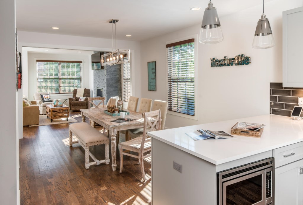 The open kitchen boasts all-new stainless steel appliances.