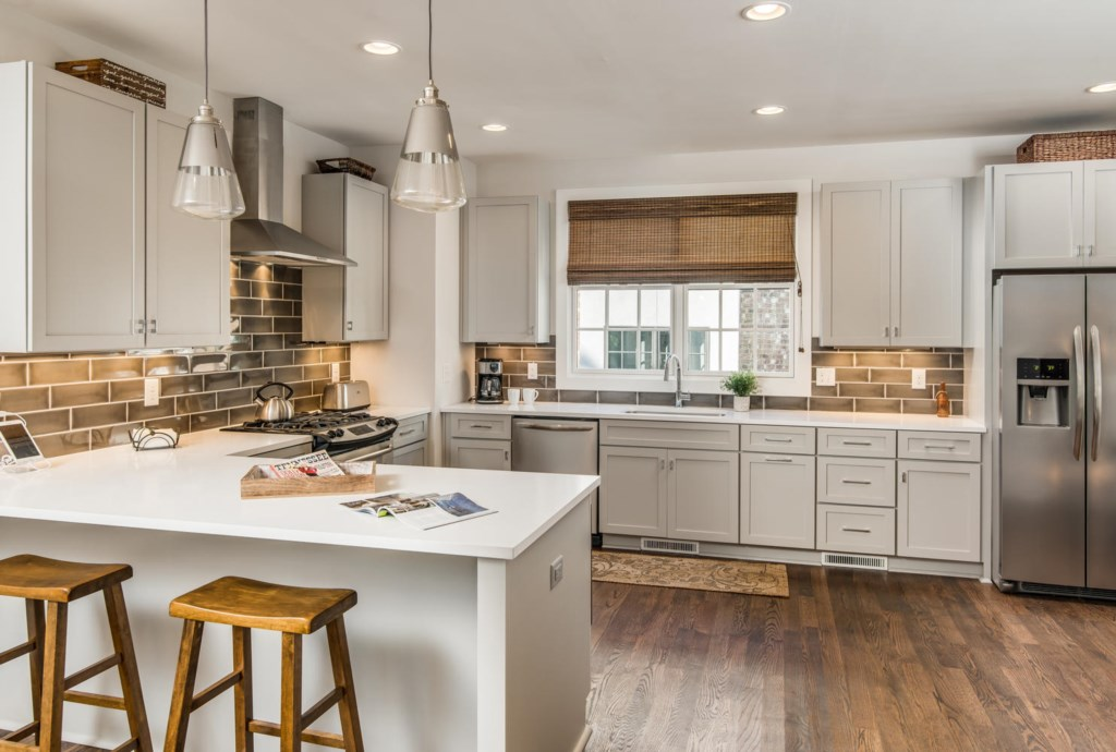 Natural light and bright colors create for a warm and inviting experience in the kitchen.