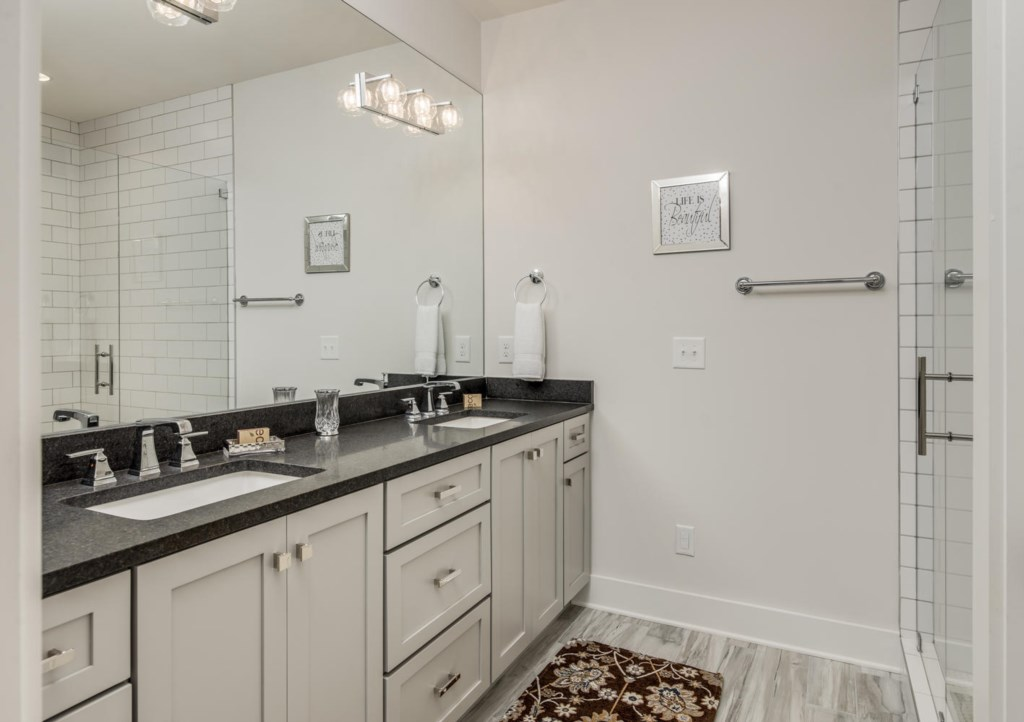 Freshen up in the en-suite master bath, outfitted with a double vanity.