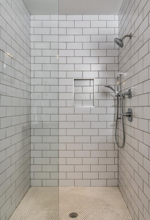 The master bath is complete with a subway-tiled walk-in shower.