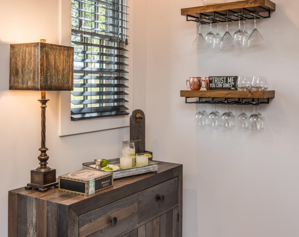 A classy, wall mounted bar can help with your cocktails.