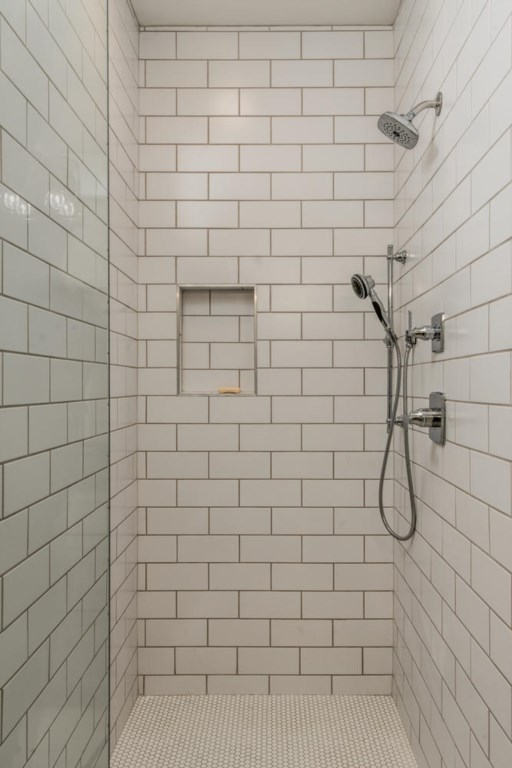 The master bath walk-in shower boasts beautiful subway tile.