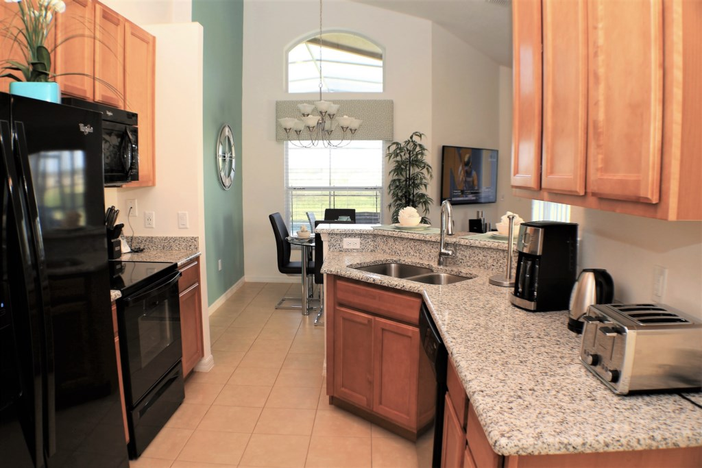 Well appointed kitchen overlooking the dining & lounge area