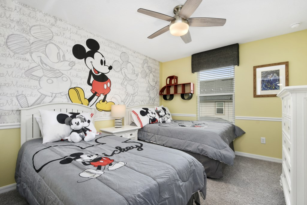 Mickey Themed Bedroom with ceiling fan