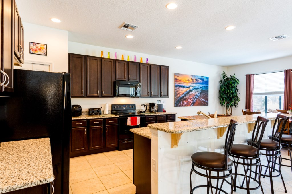 7.Kitchenwithbreakfastbarseating,6BedVacationHome,Florida