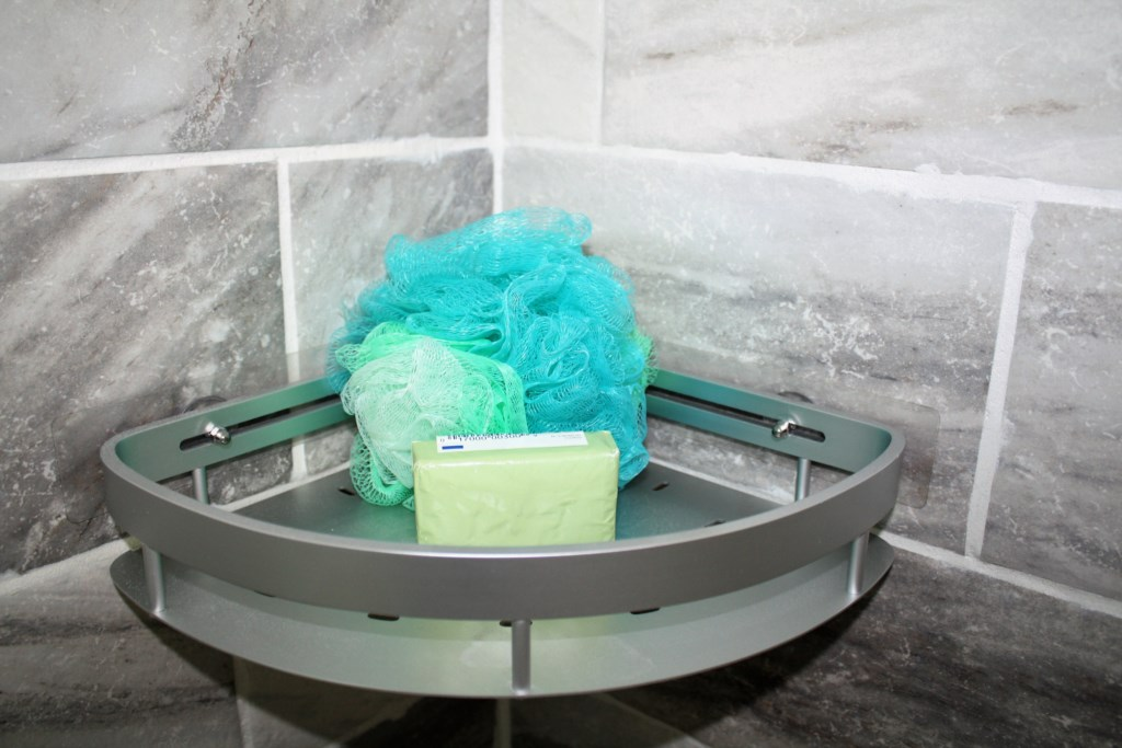 The bath scrubby and bar of Dial Antibacterial Basics soap are provided.