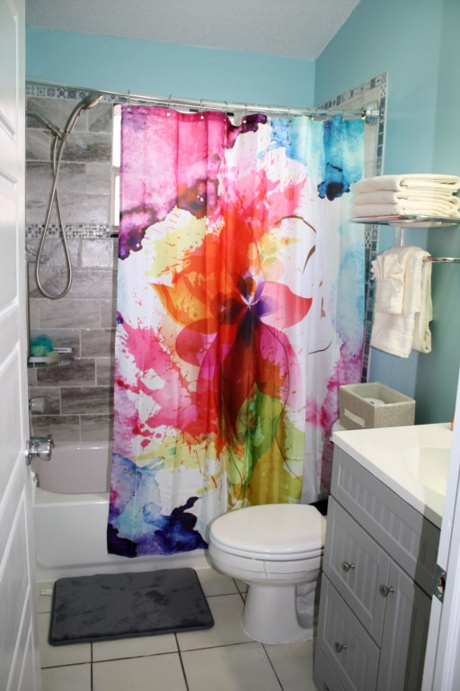 I just love this bathroom with it's bright and colorful shower curtain.