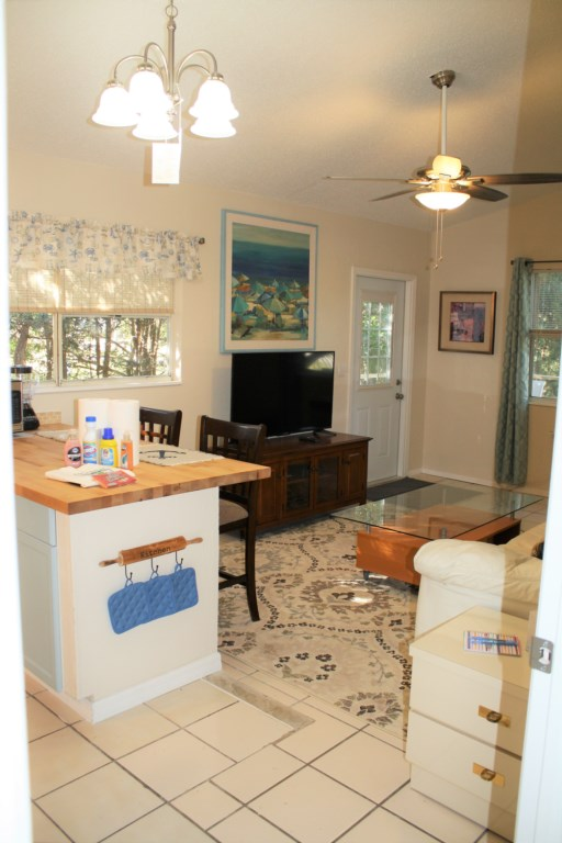 Vaulted ceilings, open kitchen,dining and 50 in. flat screen t.v.