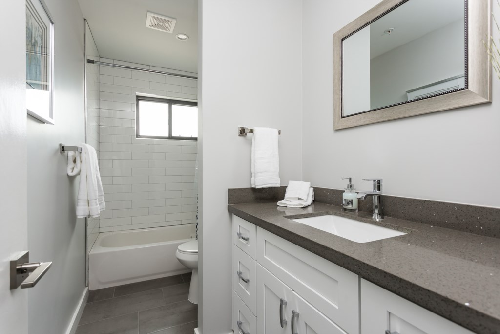 3rd Bathroom with a shower/tub combo and large vanity