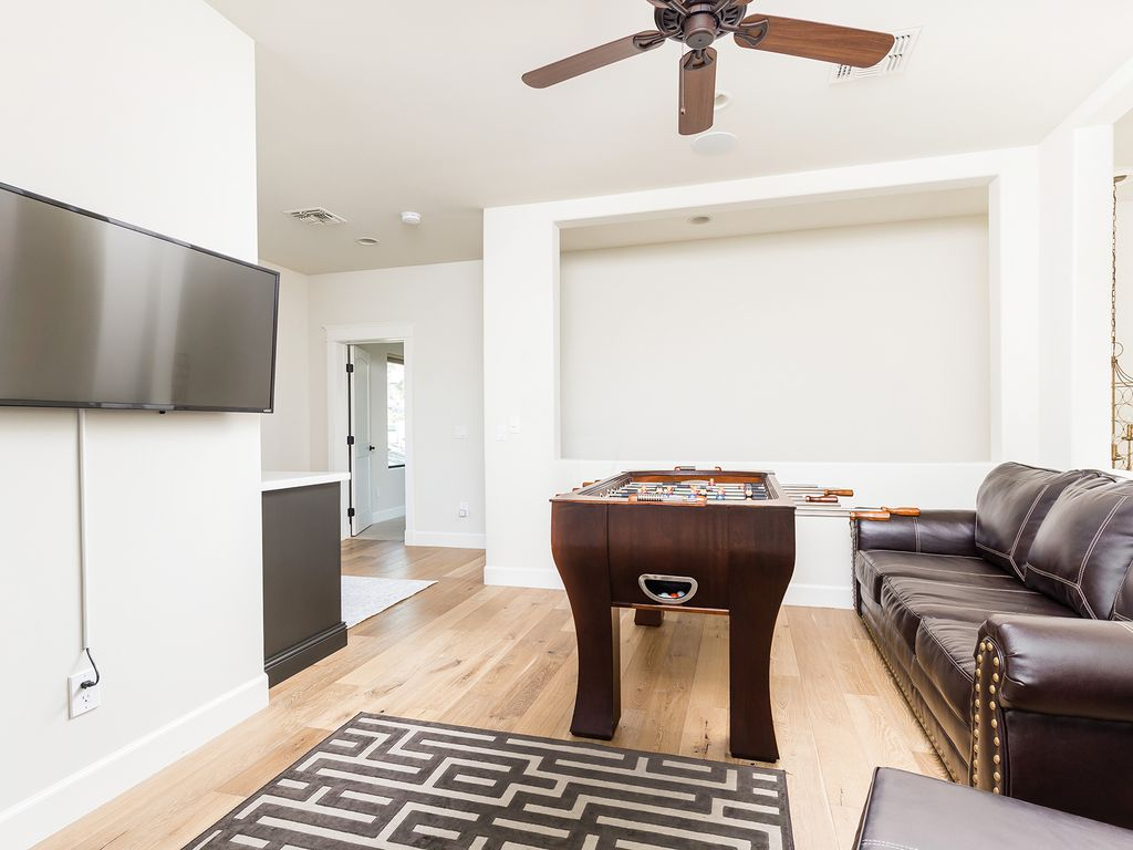 Upstairs living room/game room with foosball table and large flat screen TV
