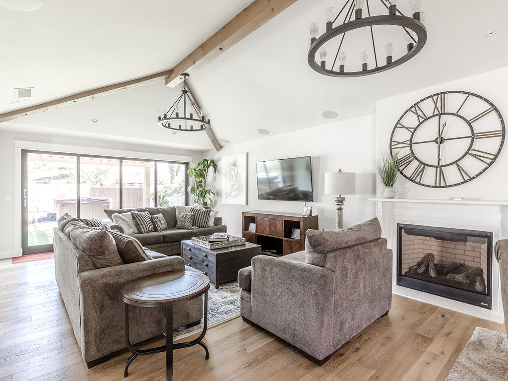 Bright beautiful living room with large flat screen TV