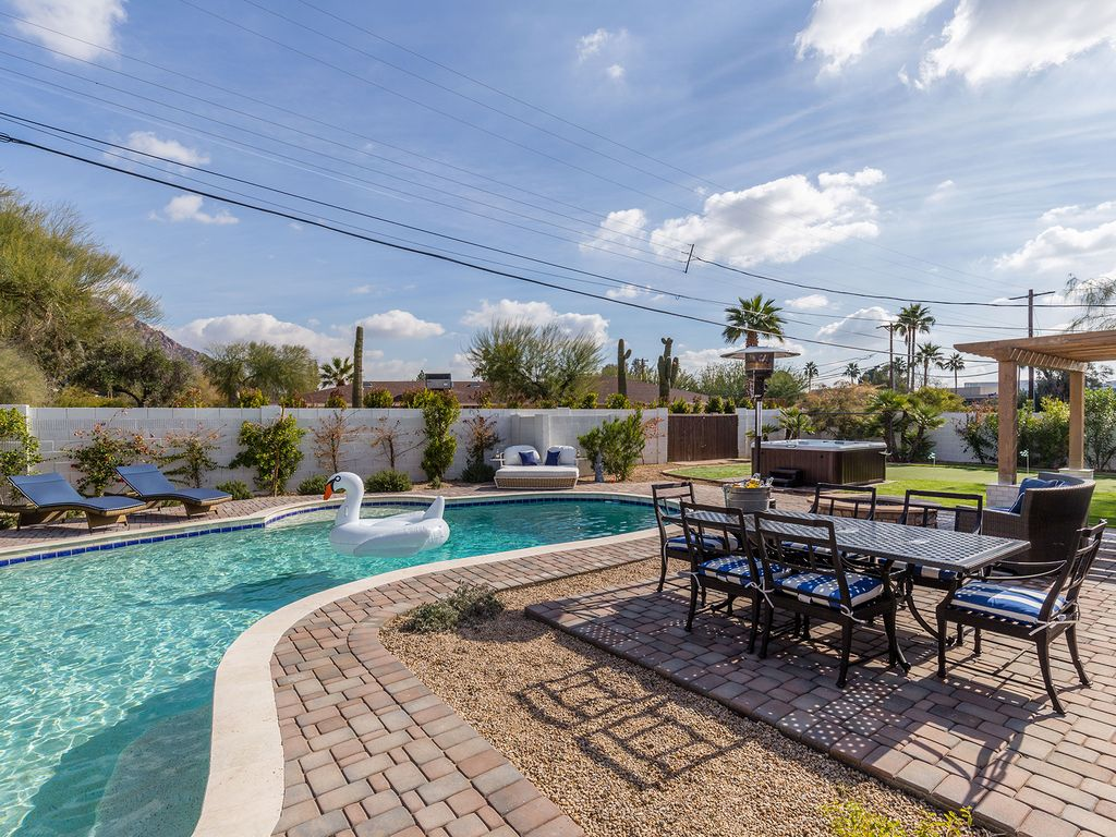 Incredible backyard oasis with private pool, jacuzzi, putting green, fire pit and multiple lounge ar