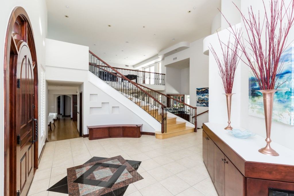 Beautiful entry way with stairs leading to the loft game room