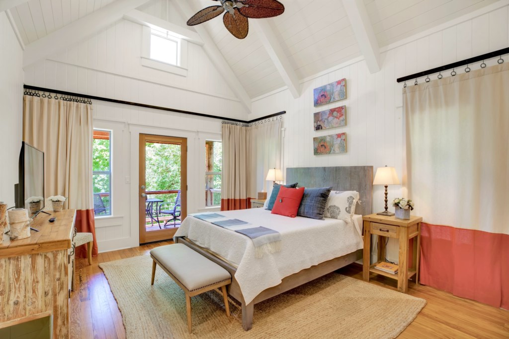 The Life Is Gruene Master Bedroom boasts an amazing space with a private balcony!